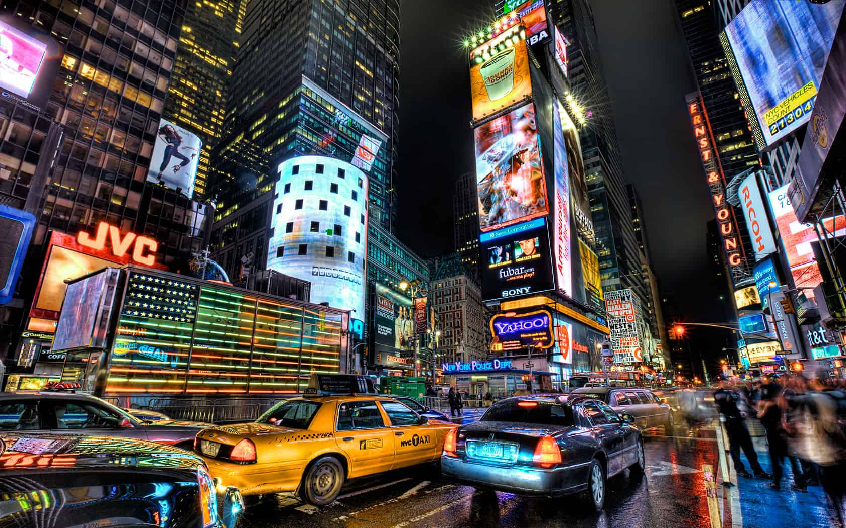 Times Square is a major commercial intersection in the borough of Manhattan in New York City, at the junction of Broadway and Seventh Avenue and stretching from West 42nd to West 47th Streets. The extended Times Square area, also called the Theatre District, consists of the blocks between Sixth and Eighth Avenues from east to west, and West 40th and West 53rd Streets from south to north, making up the western part of the commercial area of Midtown Manhattan.