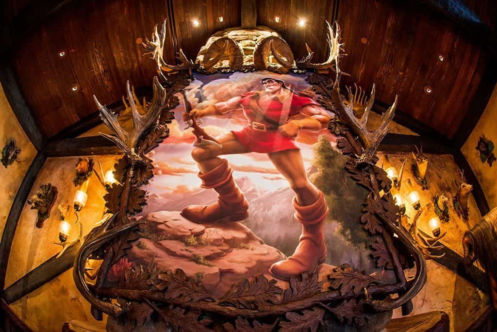 imagen gaston painting magic kingdom
