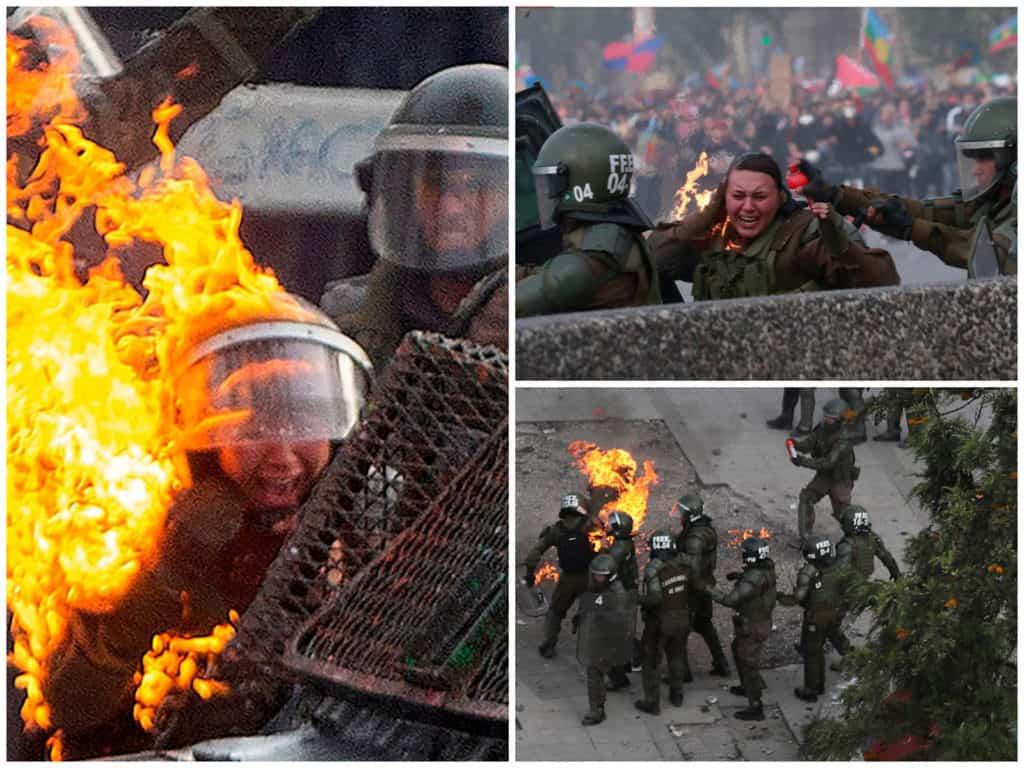 Dos mujeres policías envueltas en llamas durante una protesta en Chile